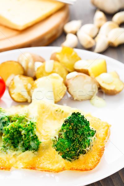 Broccoli gratin with cheese and baked potato Stock photo © vankad