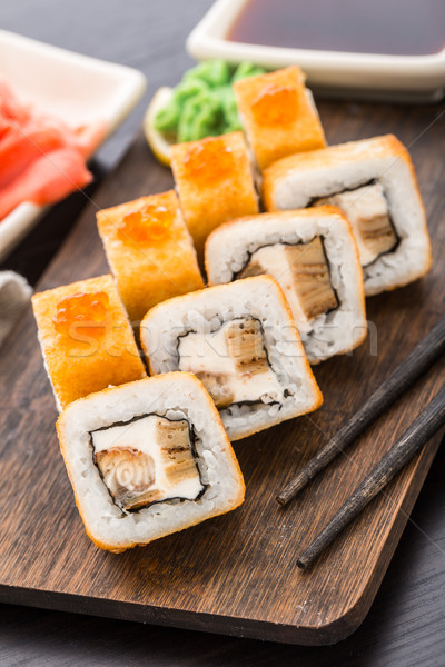 Stock photo: Fried sushi roll with eel and japanese omelette