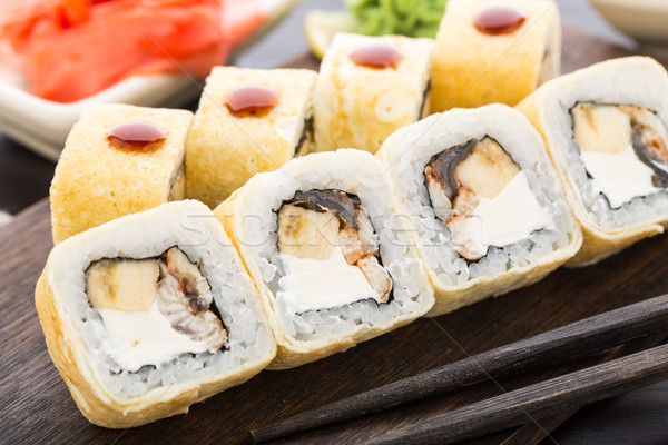 Stock photo: Sushi rolls with smoked eel and banana