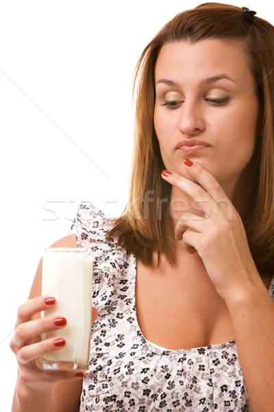 Young woman holding glass of milk Stock photo © vankad