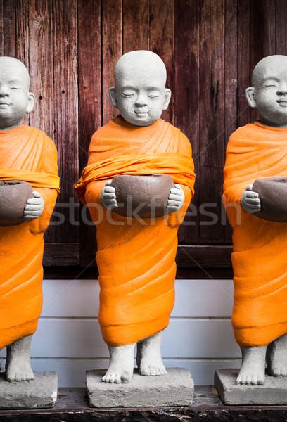 монах статуя чаши оранжевый халат Сток-фото © vankad