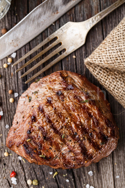 Beef steak on a wooden board Stock photo © vankad
