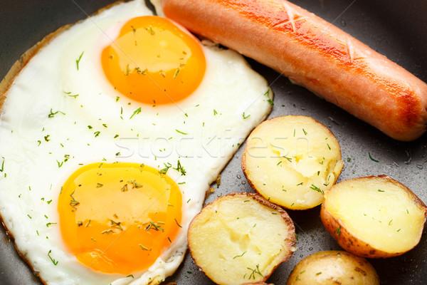 Desayuno huevos salchicha papa pan alimentos Foto stock © vankad
