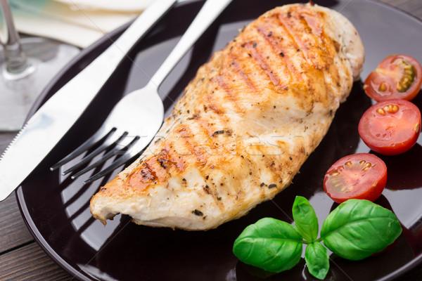 Pollo a la parrilla pechos placa alimentos cena tomate Foto stock © vankad