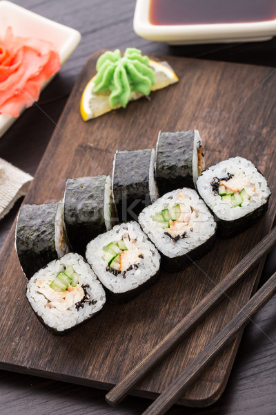 Sushi rolls with eel, cucumber and sesame seed Stock photo © vankad