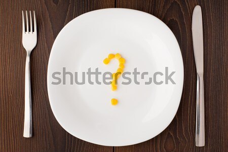 Question mark made of corn seeds on plate Stock photo © vankad