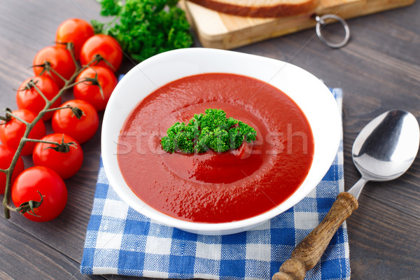 Tasty tomato soup with herbs Stock photo © vankad