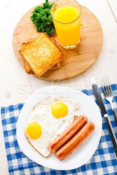 Сток-фото: жареный · яйца · пластина · оранжевый · таблице