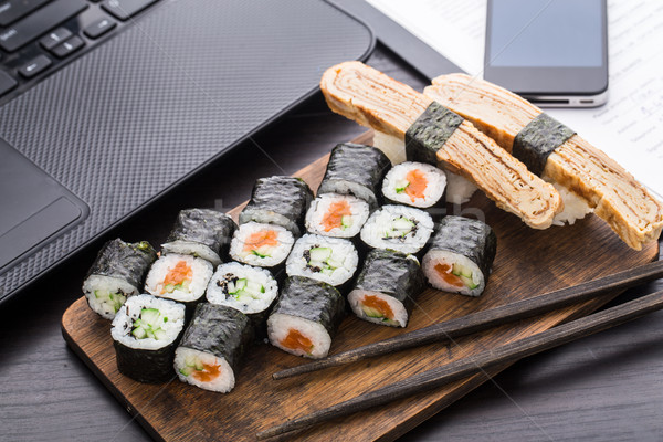 Stock photo: Quick sushi lunch in the office