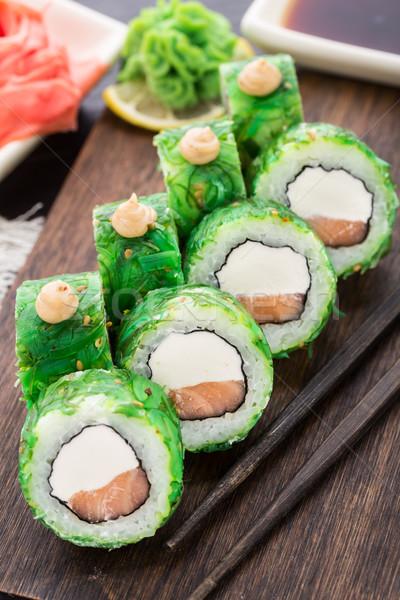 Sushi rolls covered with chuka Stock photo © vankad