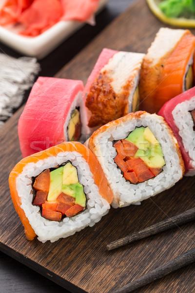 Rainbow sushi roll with salmon, tuna and eel Stock photo © vankad