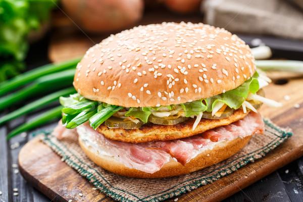 Burger with potato pancake and bacon Stock photo © vankad