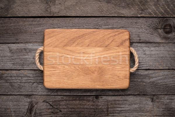 Chopping board on rustic table Stock photo © vankad