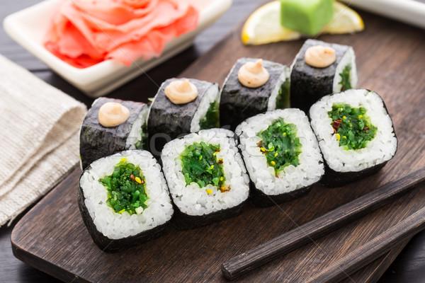 Sushi rolls with chuka salad Stock photo © vankad