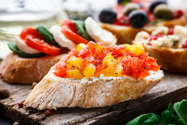 Bruschetta with chopped tomatoes, herbs and oil Stock photo © vankad