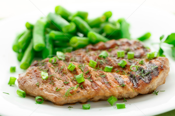 Beef steak with green beans Stock photo © vankad