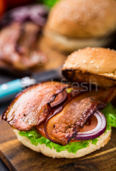 Home made burger on wooden board Stock photo © vankad