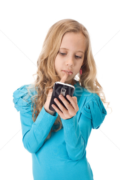 Girl playing games in her phone Stock photo © vankad