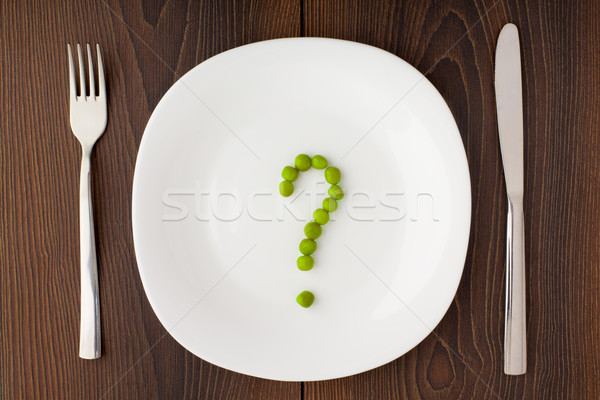 Question mark made of peas on plate Stock photo © vankad