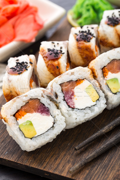 Sushi roll with salmon, tuna and eel Stock photo © vankad