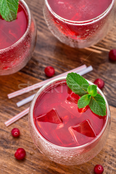 Cranberry cocktail with mint garnish. Stock photo © vankad