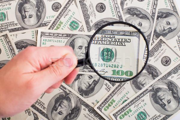 Dollari nero lente di ingrandimento carta mano Foto d'archivio © vankad
