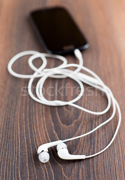 Earphones and cell phone Stock photo © vankad