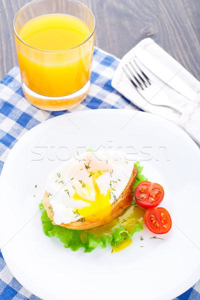 Poached egg with dill on bread Stock photo © vankad