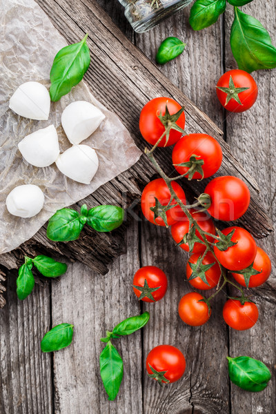Tomates cherry albahaca hojas mozzarella queso Foto stock © vankad