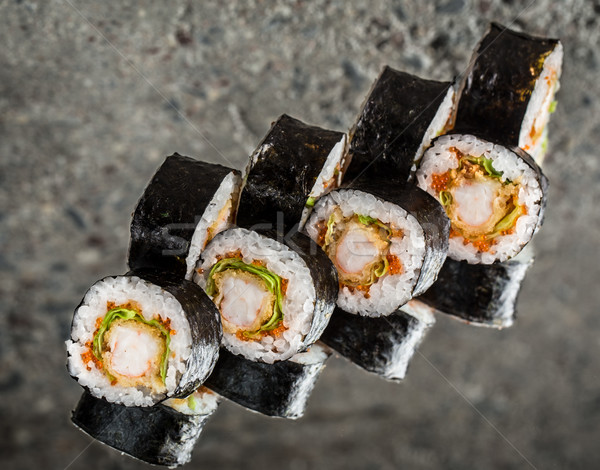 Sushi roll with shrimp, lettuce and tobiko Stock photo © vankad