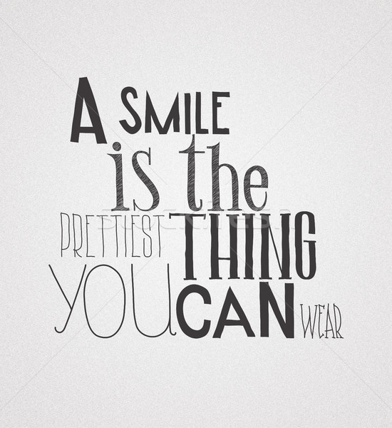 Poster  quote  A smile is the prettilest thing you can wear Stock photo © Vanzyst