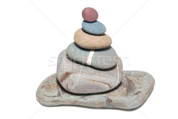Pyramid of stones isolated on white. Stock photo © vapi