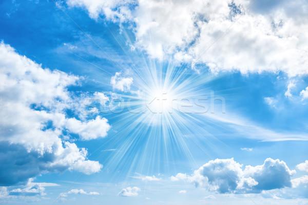 Sun with sunrays shining on blue sky Stock photo © vapi