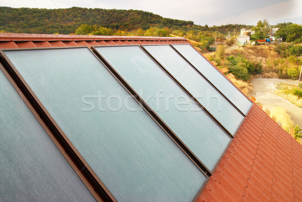 Solar panel (geliosystem) on the house roof. Stock photo © vapi