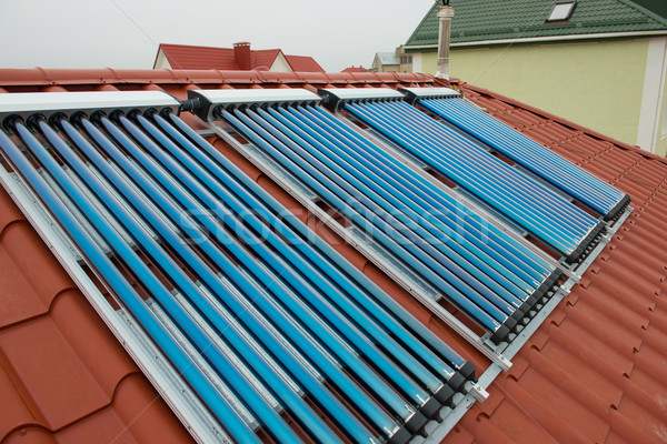 Vacuum collectors- solar water heating system Stock photo © vapi