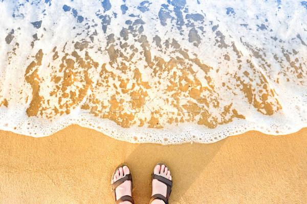Stóp sandały piasek na plaży żółty niebieski morza Zdjęcia stock © vapi