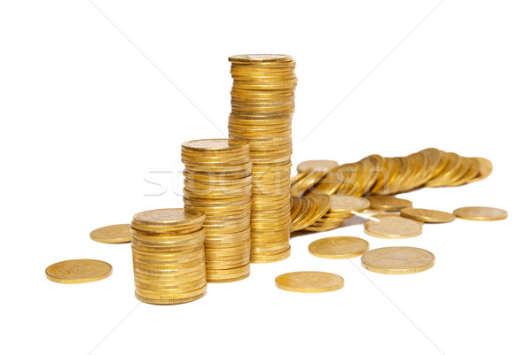 Columns of golden coins isolated on white. Stock photo © vapi