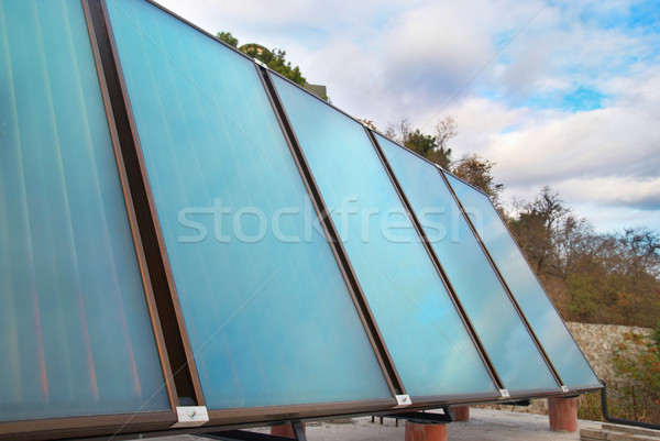 Nap víz fűtés ház tető égbolt Stock fotó © vapi