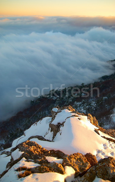 Stock photo: Sunset on snow-covered mountains.