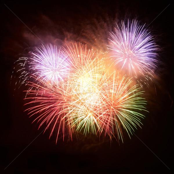 Foto stock: Colorido · fogos · de · artifício · preto · céu · feliz · abstrato