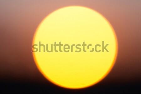 Groot Rood star zon zonsondergang horizon Stockfoto © vapi