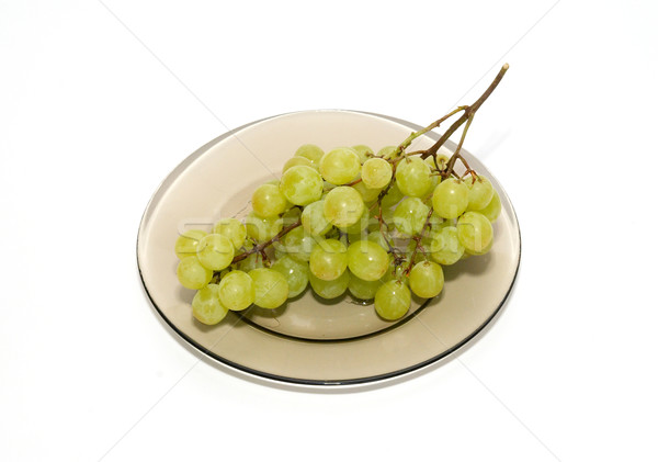 Green grapes on the plate isolated on white. Stock photo © vapi