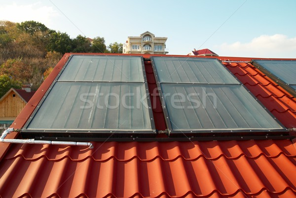 Alternative energy- solar system on the house roof. Stock photo © vapi