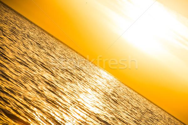 Wygaśnięcia powyżej morza chmury niebo plaży Zdjęcia stock © vapi