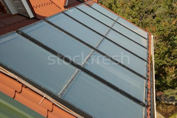 Alternative energy- solar system on the house roof. Stock photo © vapi
