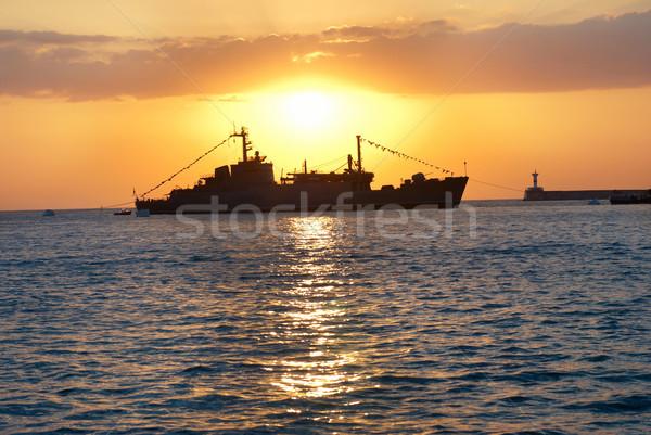 Military ship against sunset Stock photo © vapi