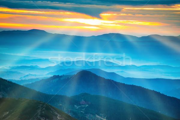 Mavi dağlar tepeler gün batımı güzel turuncu Stok fotoğraf © vapi