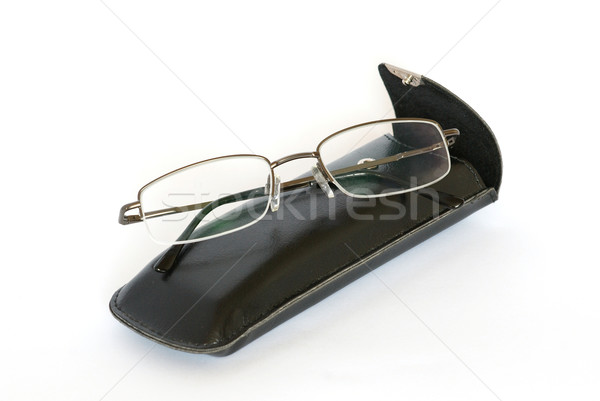 Spectacles and spectacle-case isolated on white. Stock photo © vapi