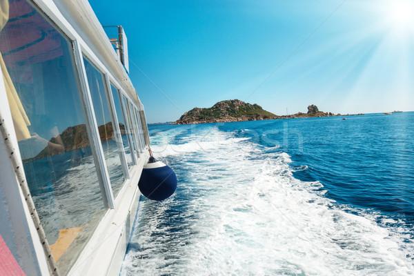 Waves on blue sea behind the boat  Stock photo © vapi
