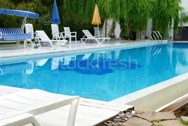 Piscina hotel azul relaxante água casa Foto stock © vapi